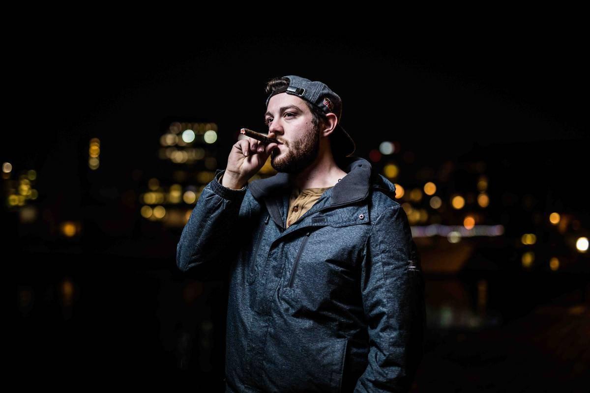 man at nighttime smoking outside