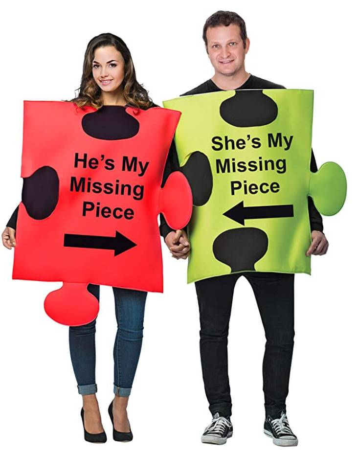 man and woman dressed as puzzle pieces that each say