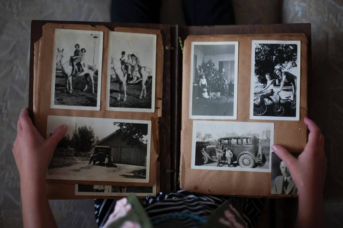 open photo album with black and white vintage pictures inside