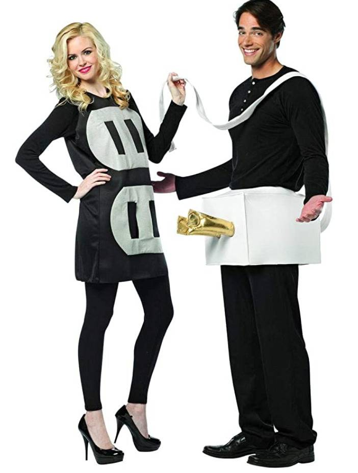 woman dressed as electrical outlet and man dressed as plug with prongs in front of hips