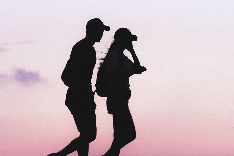 silhouettte couple at sunset walking