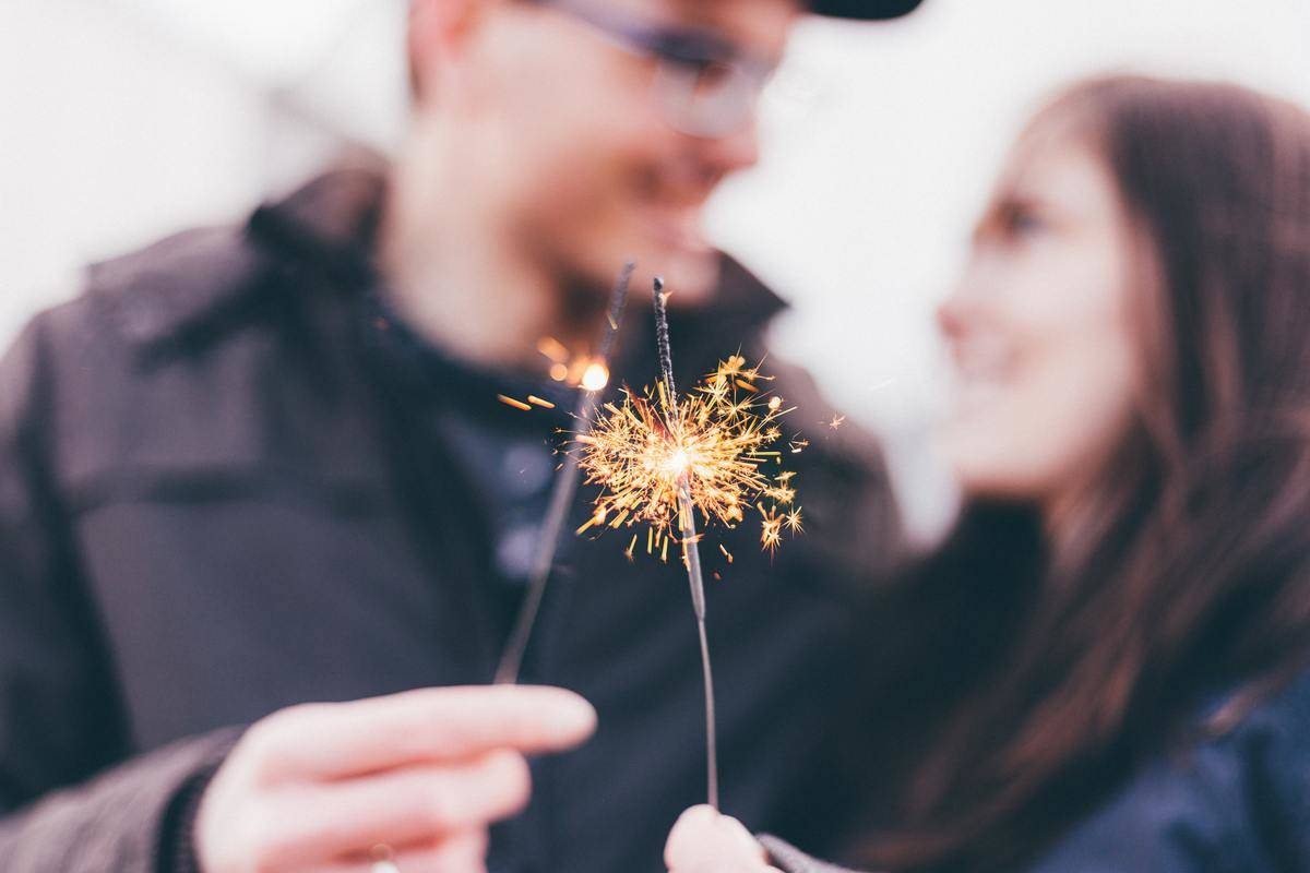 couple playing with sparklers