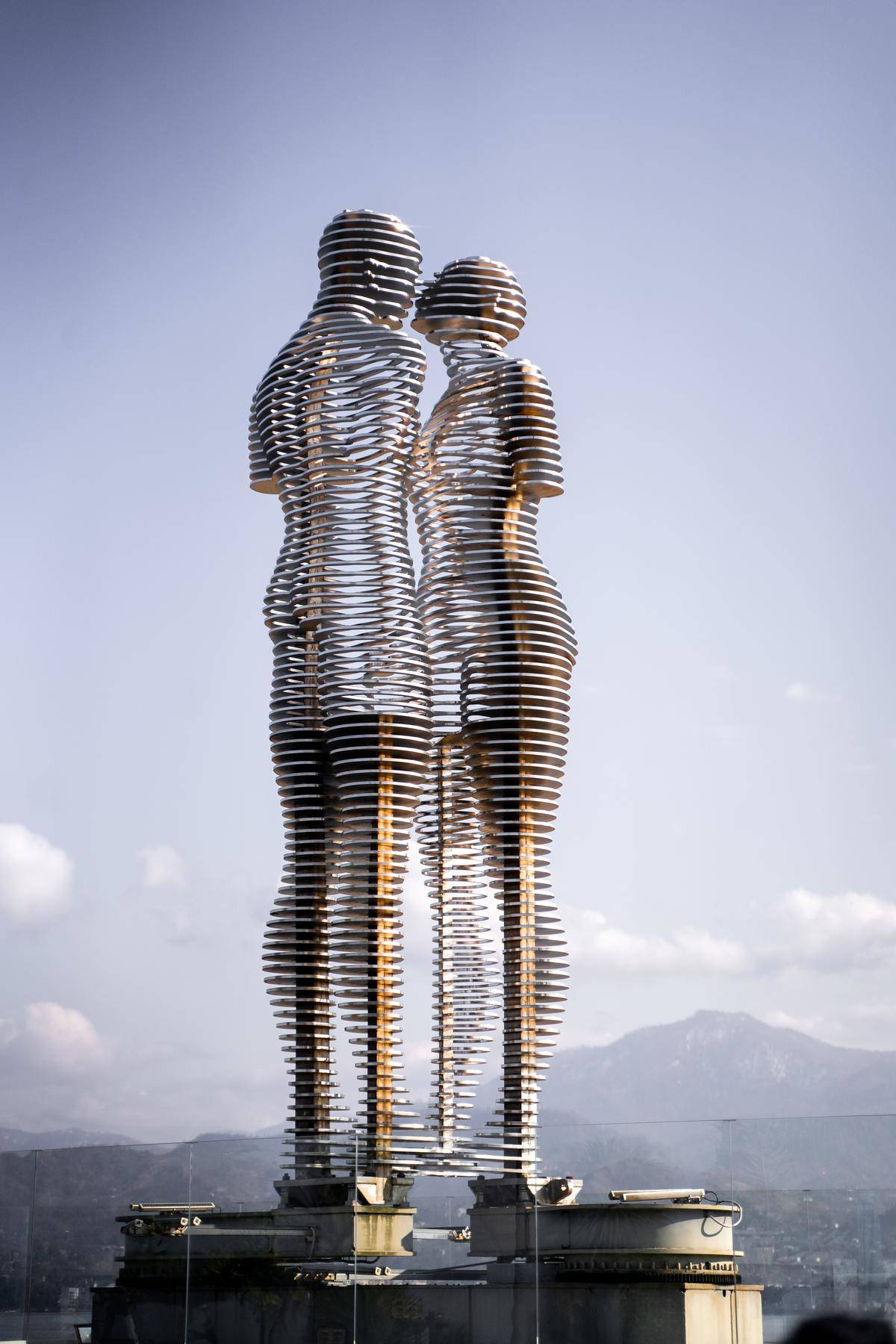 statue of man and woman facing each other