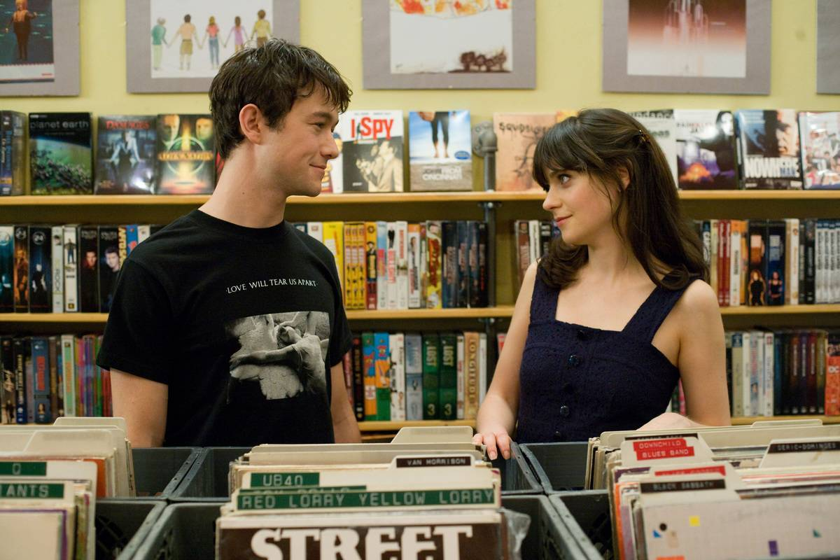still of summer and tom looking at each other in a record shop