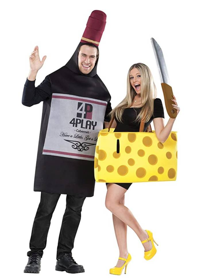 man dressed as wine bottle and woman dressed as cheese wedge