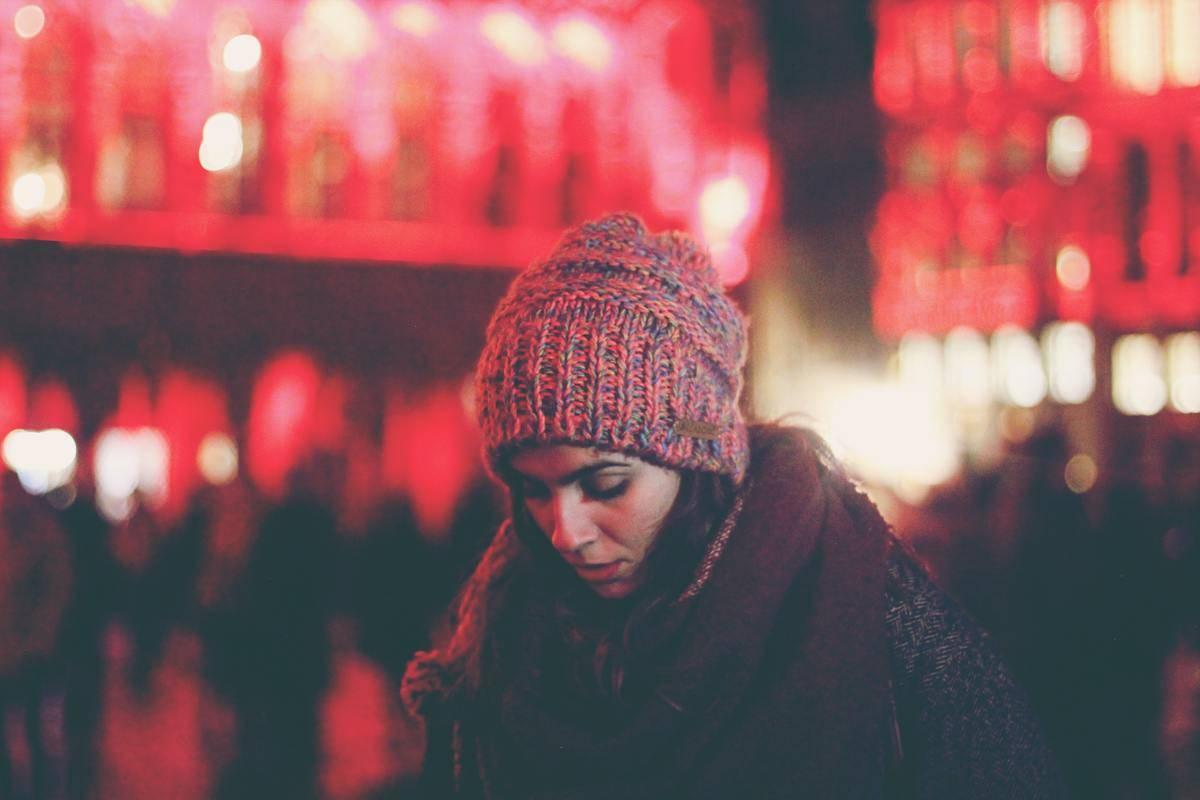 woman head down outside winter