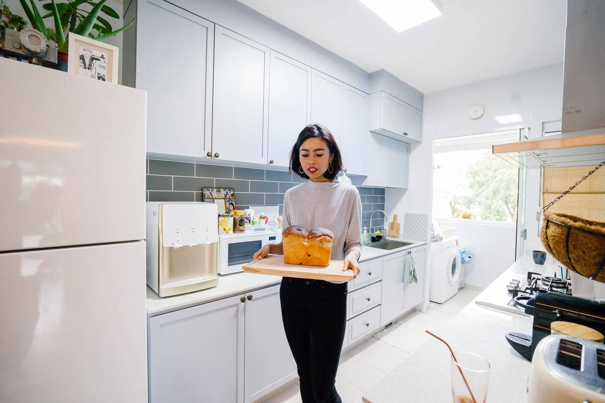 woman with drinks in kitchen