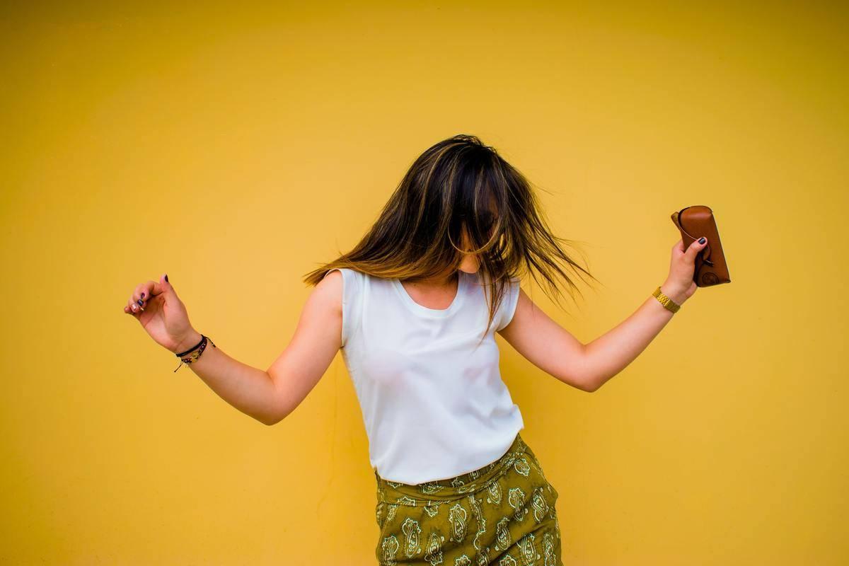 woman dances to music