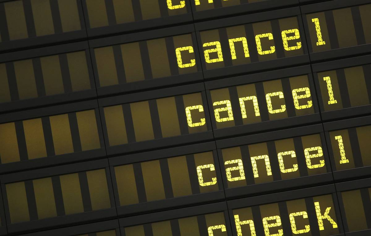 A departures board shows cancellations