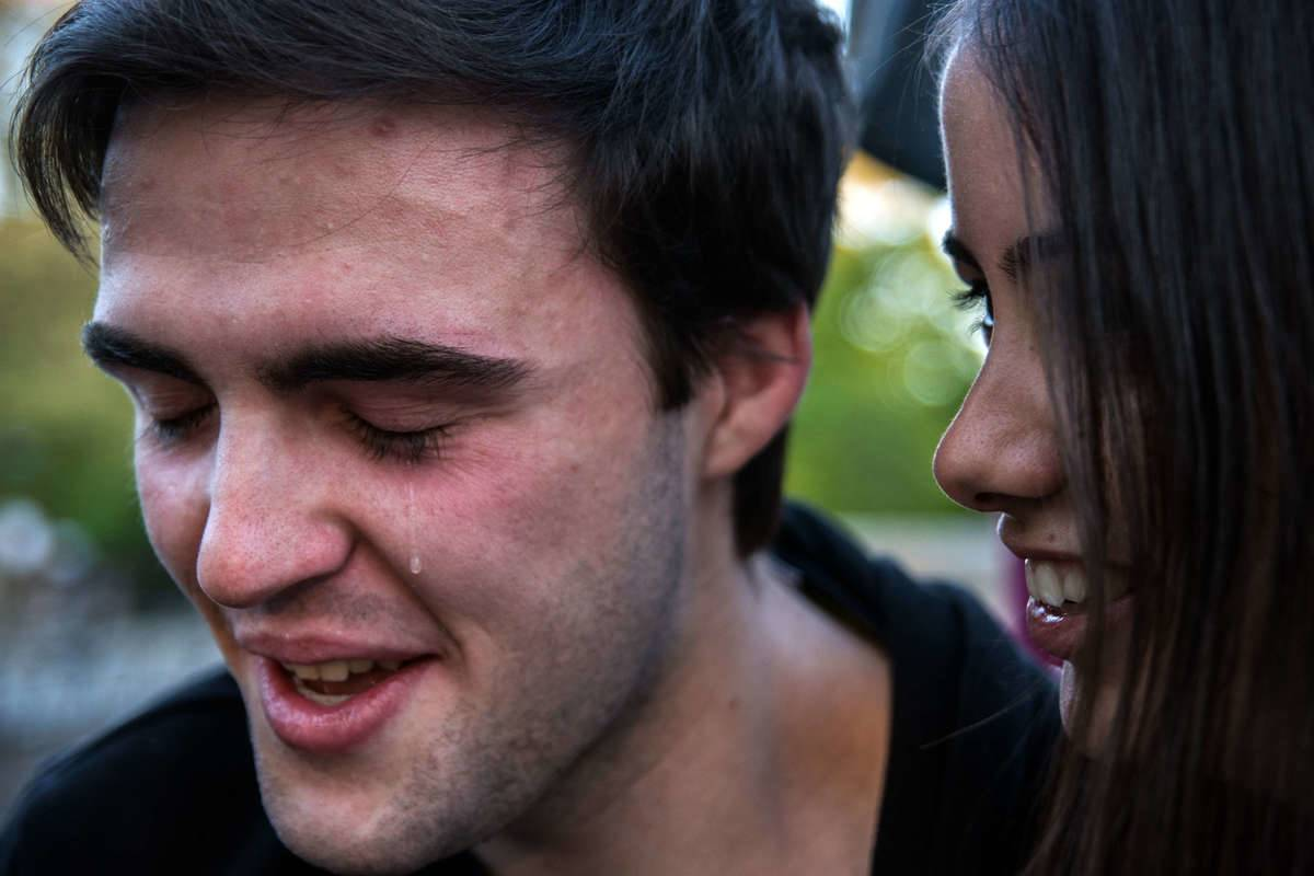 A man crying with woman next to him