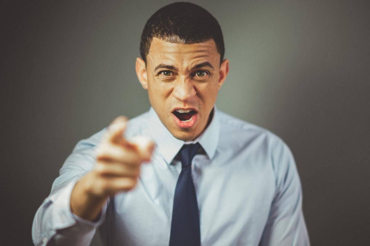 Man pointing finger in anger