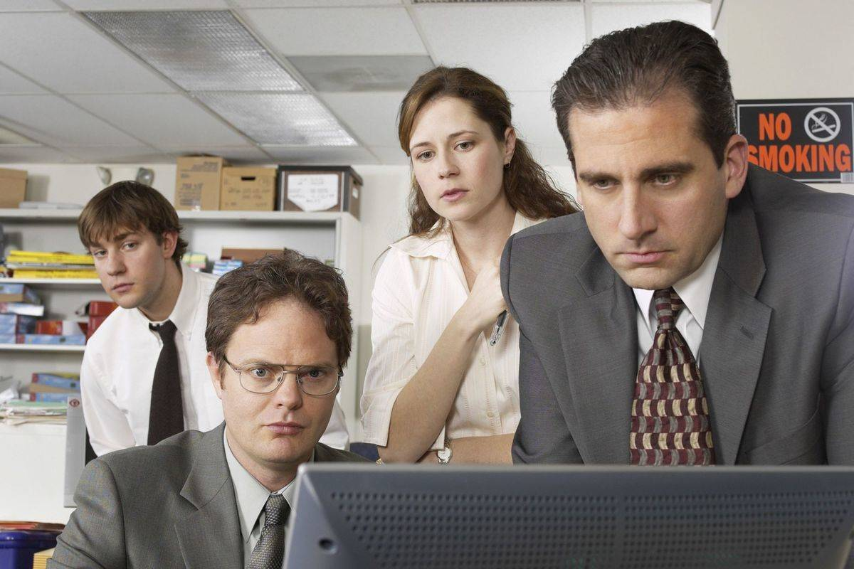 characters from The Office looking at a computer