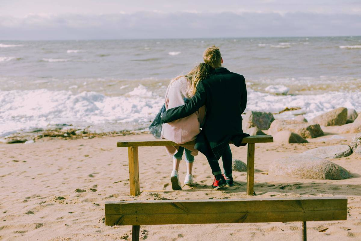 couple sitting on the beach together