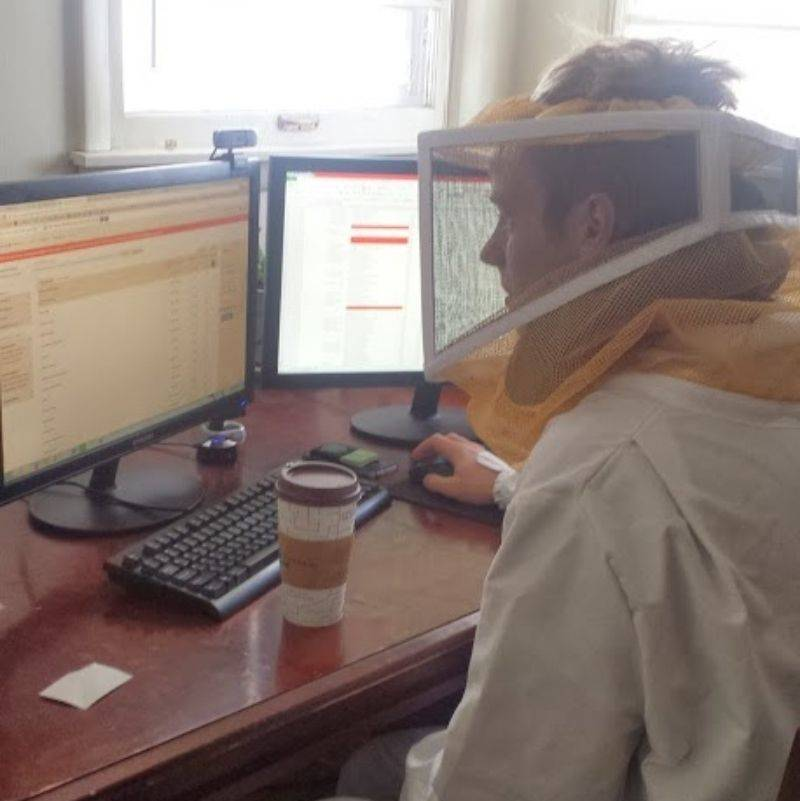 someone dressed up as a beekeeper because he is very excited about getting bees