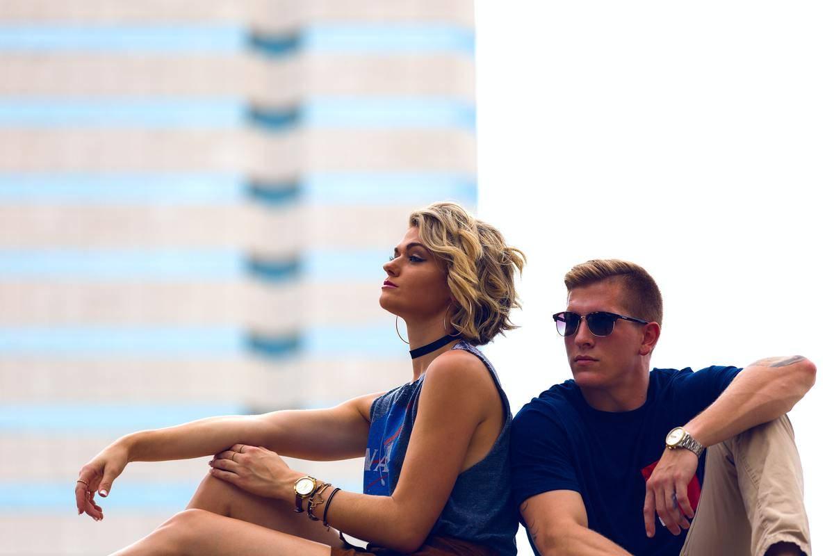couple sitting around some buildings