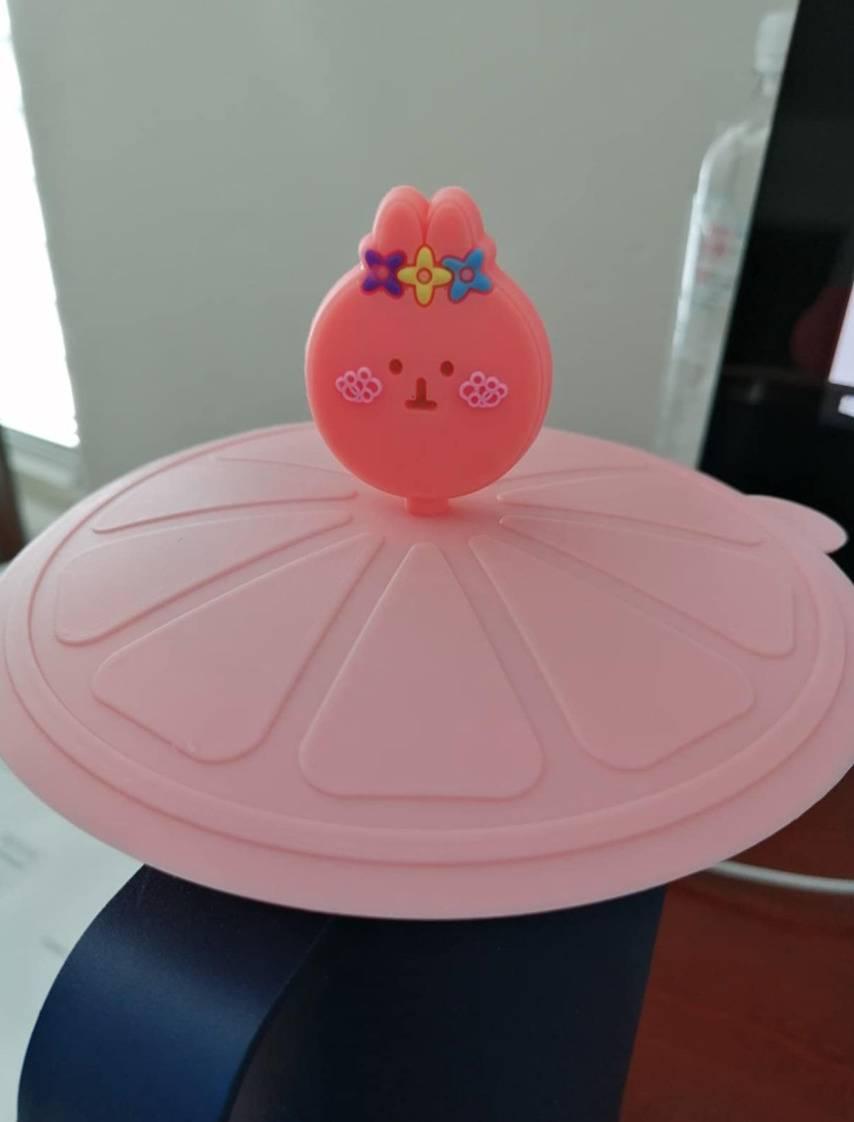 the bunny lid on top of a mug
