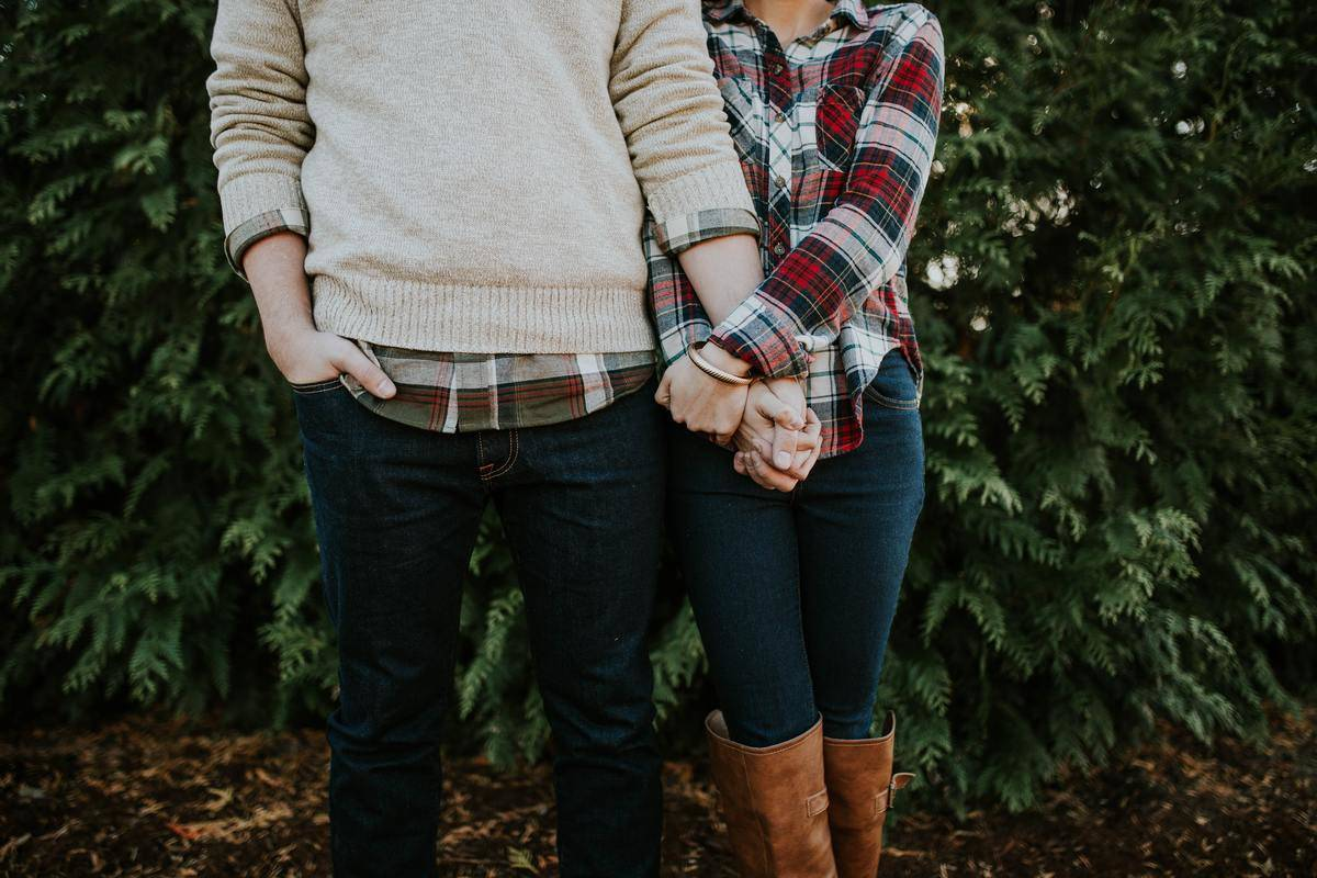 couple stands and holds hands