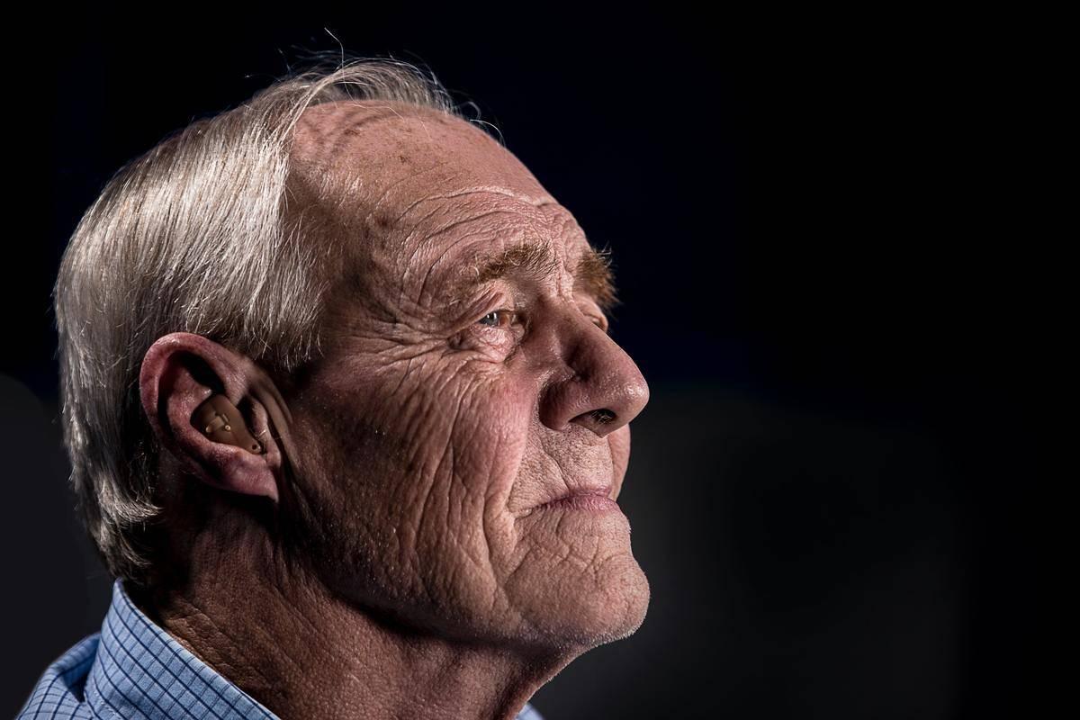 elderly man looking into distance