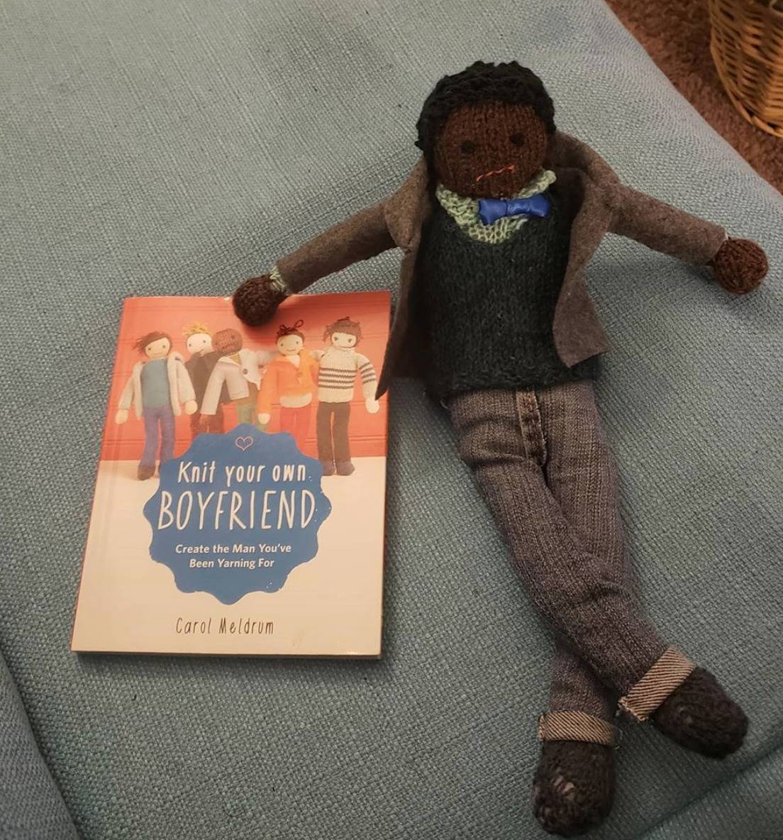 knitted boyfriend with dark hair, jeans, and a blazer