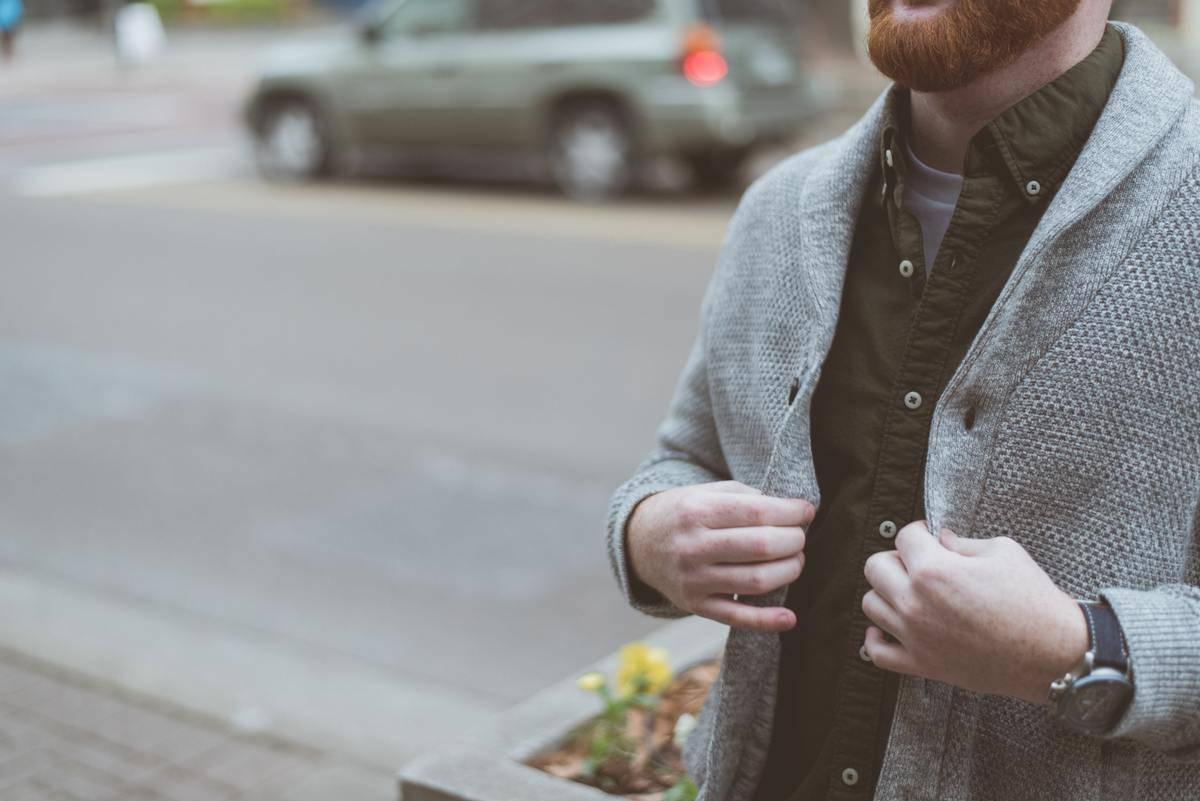 man with beard wearing big cardigan