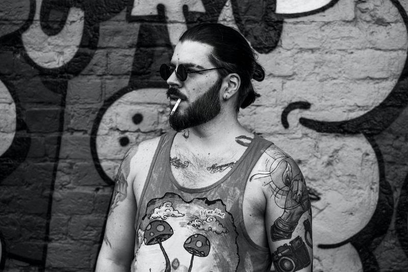 man with tattoos and beard