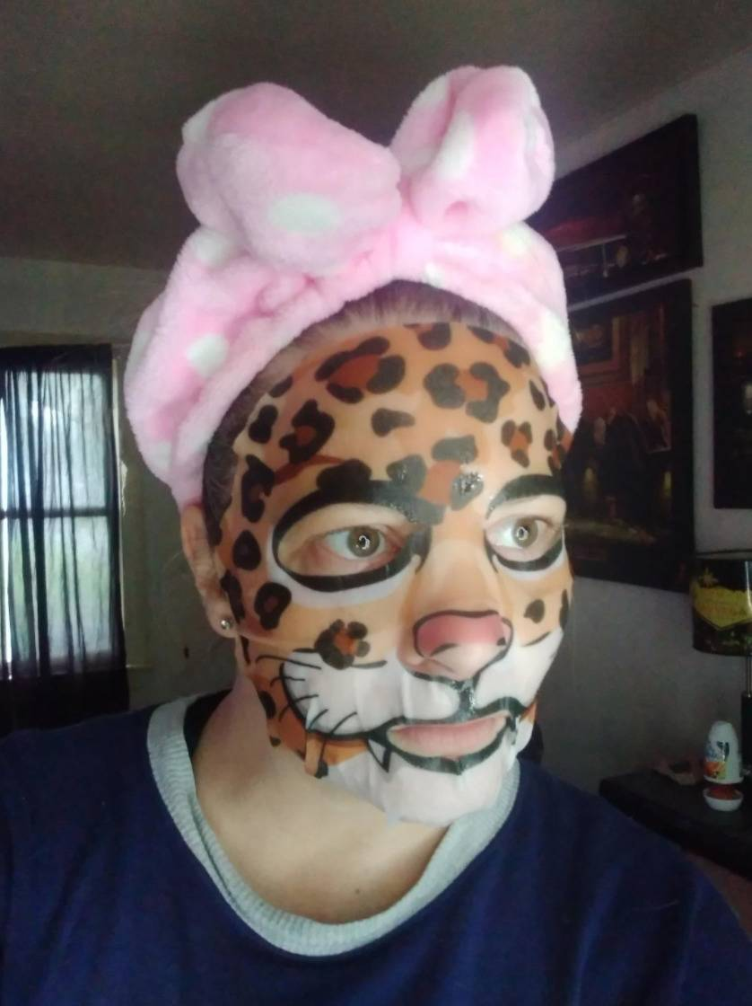 woman wearing a face mask that makes her look like a cheetah