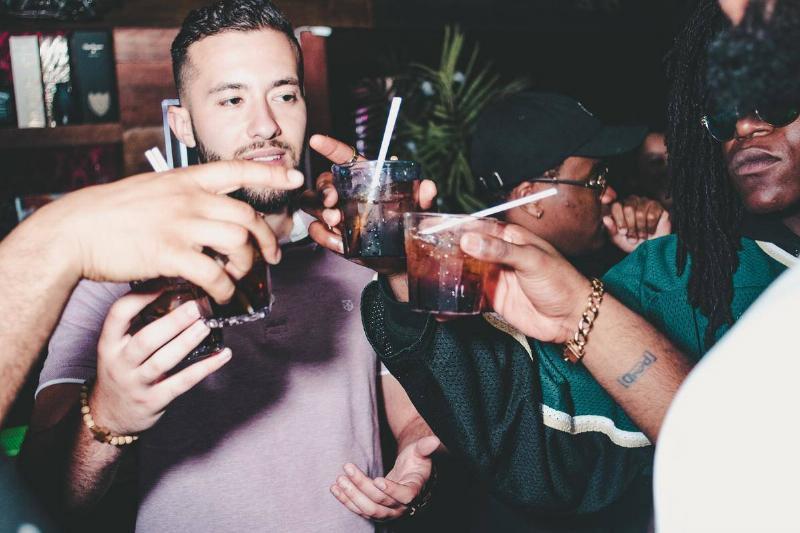 men sharing a drink at the bar