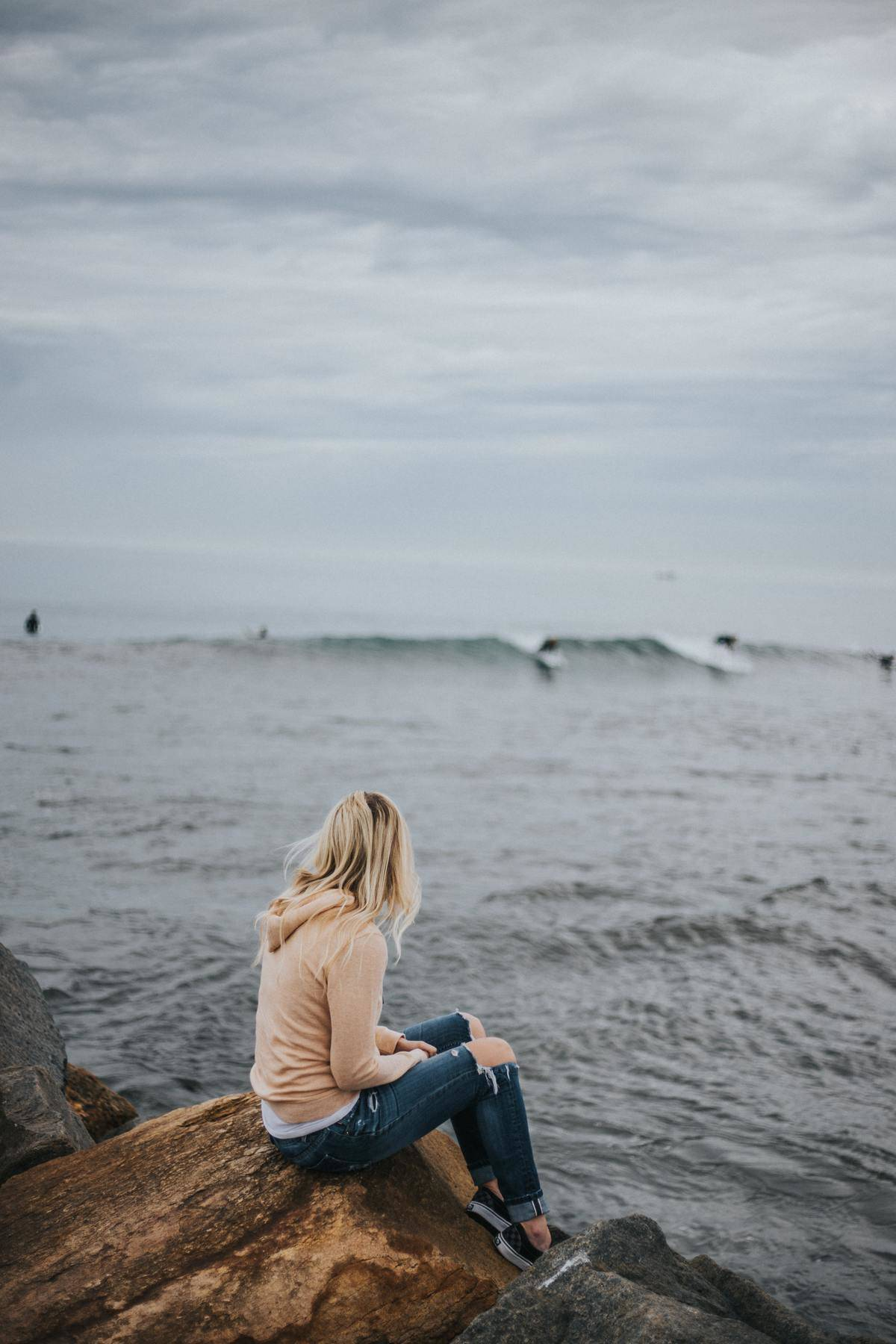 woman sitting near ocean
