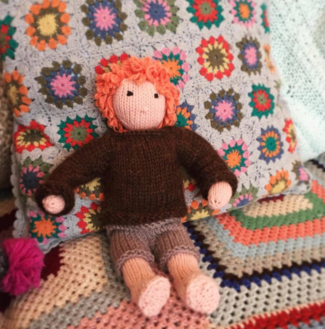knitted boyfriend with red hair sitting on bed