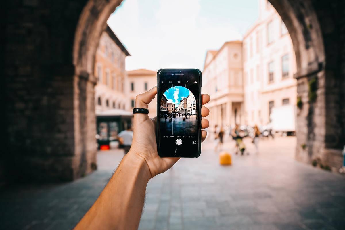 person taking travel photo