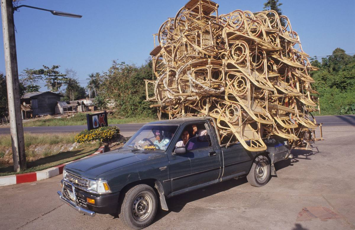 rattan furniture stacked on back of truck