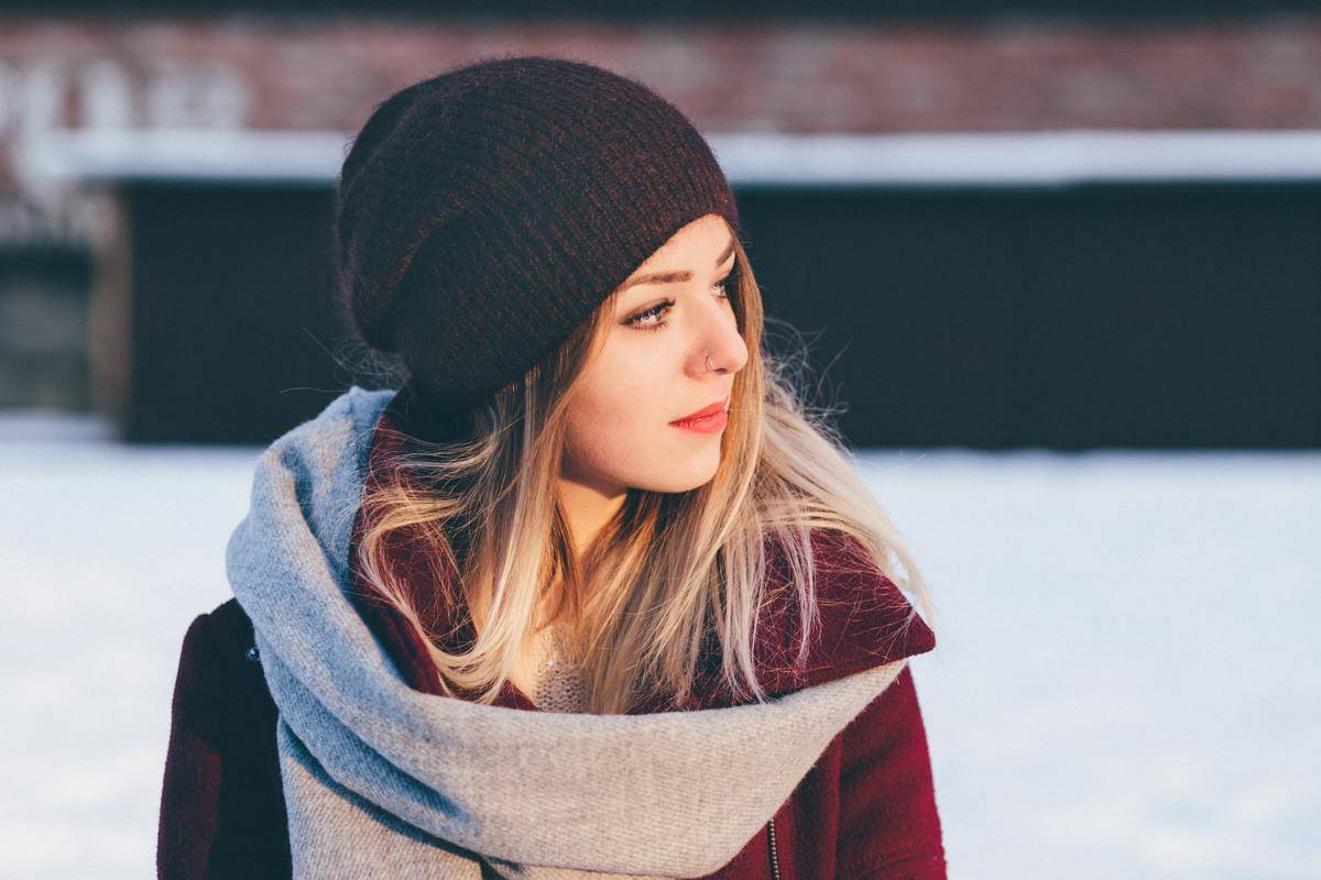 girl sitting outside in the snow
