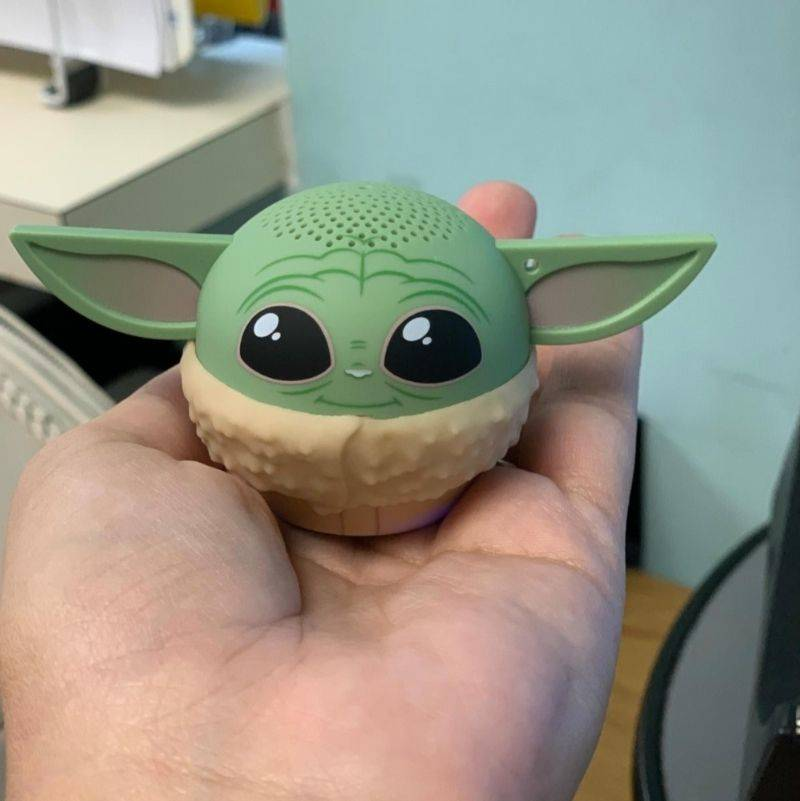 a tiny speaker that looks like baby yoda