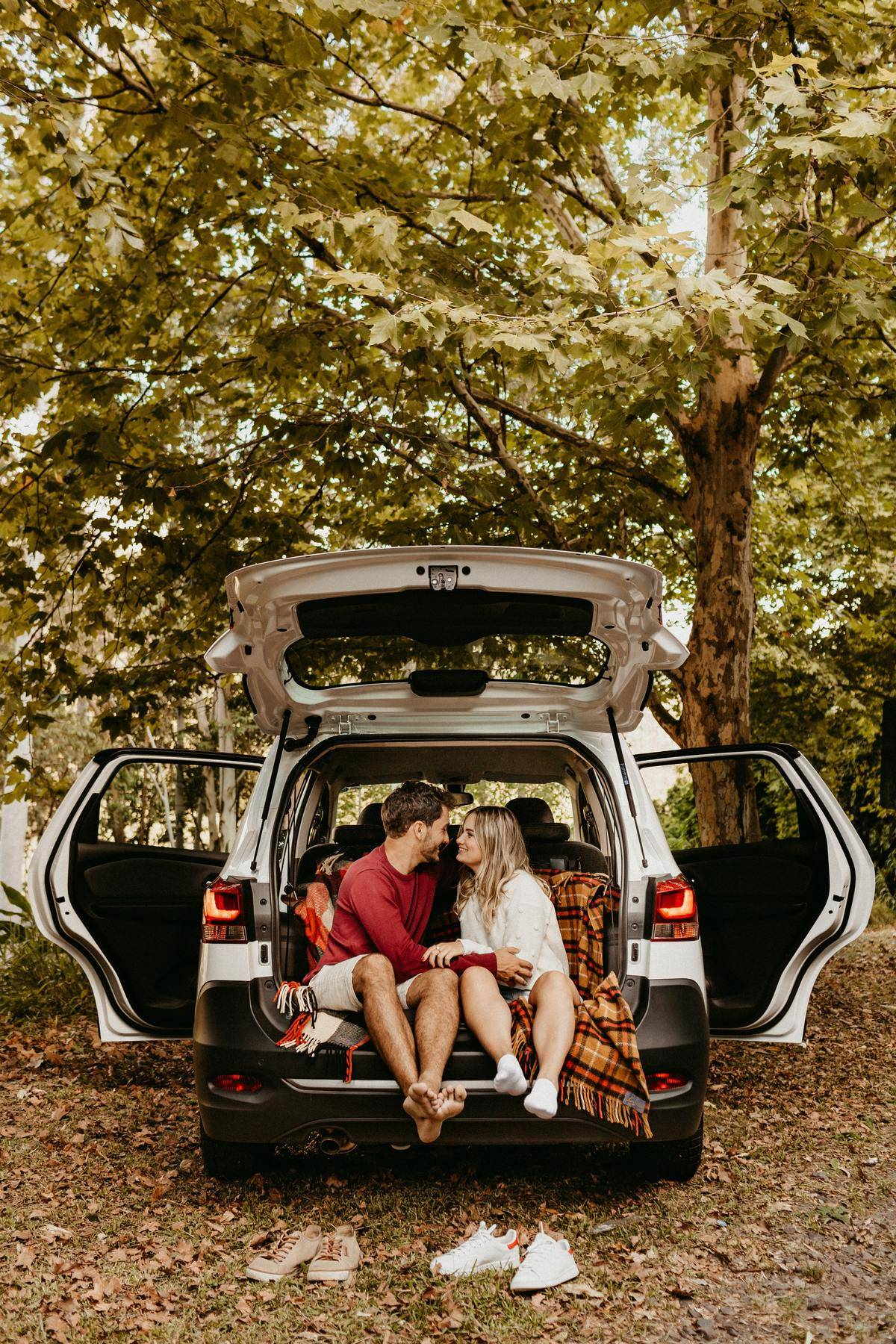 couple sitting on a trunk together