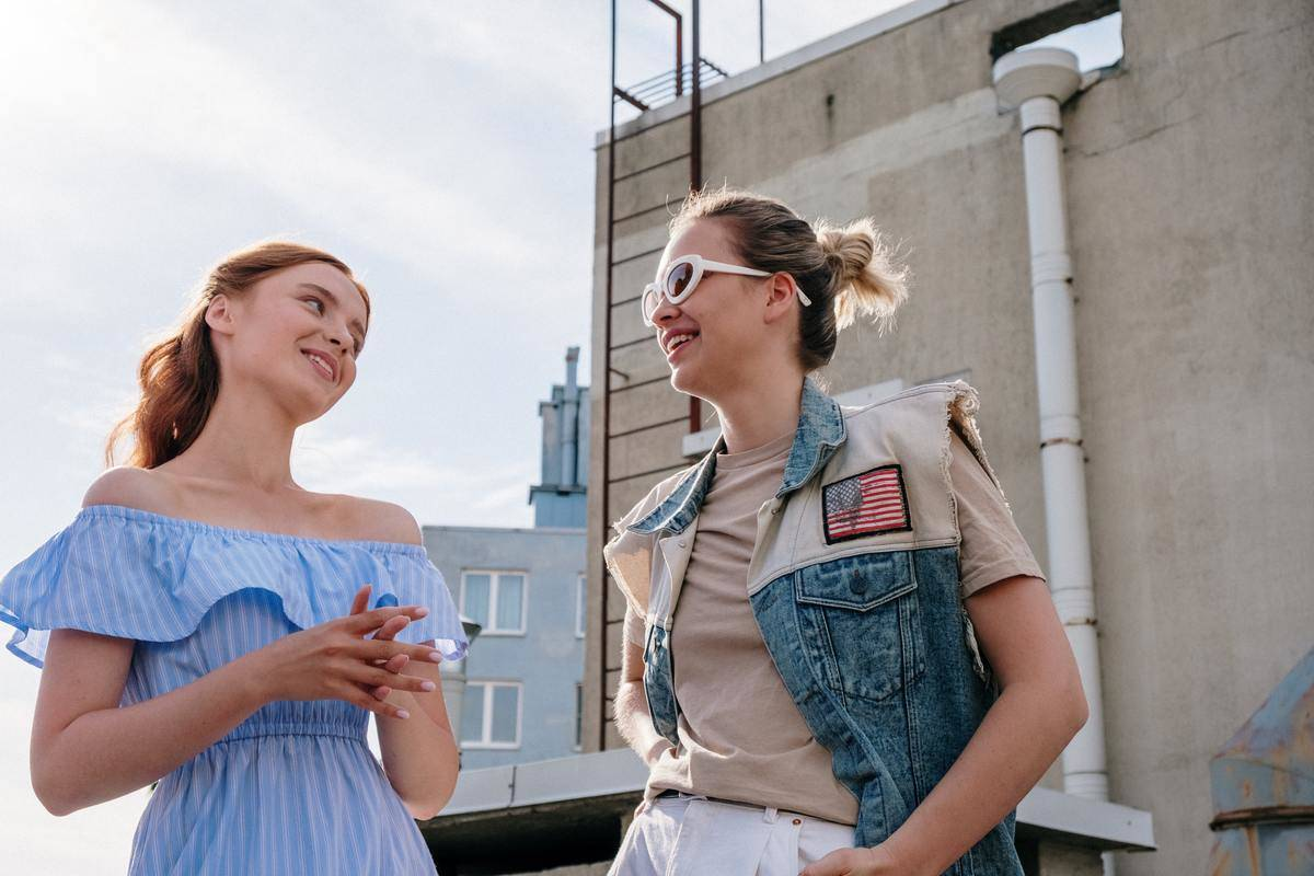 two women on rooftop sunny day