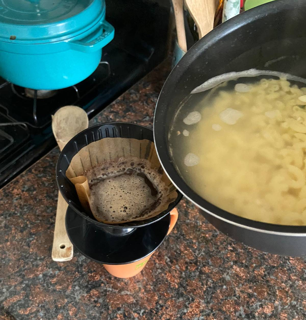 someone using pasta water to make coffee