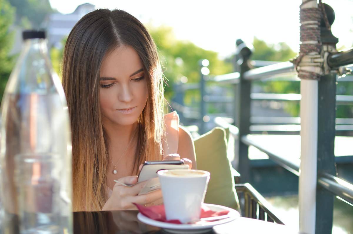 woman scrolling on phone screen