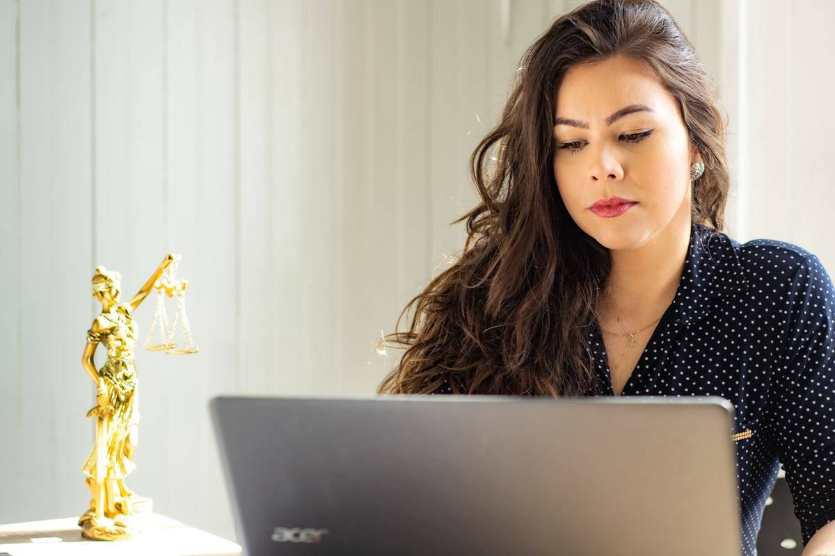 woman typing on computer at desk