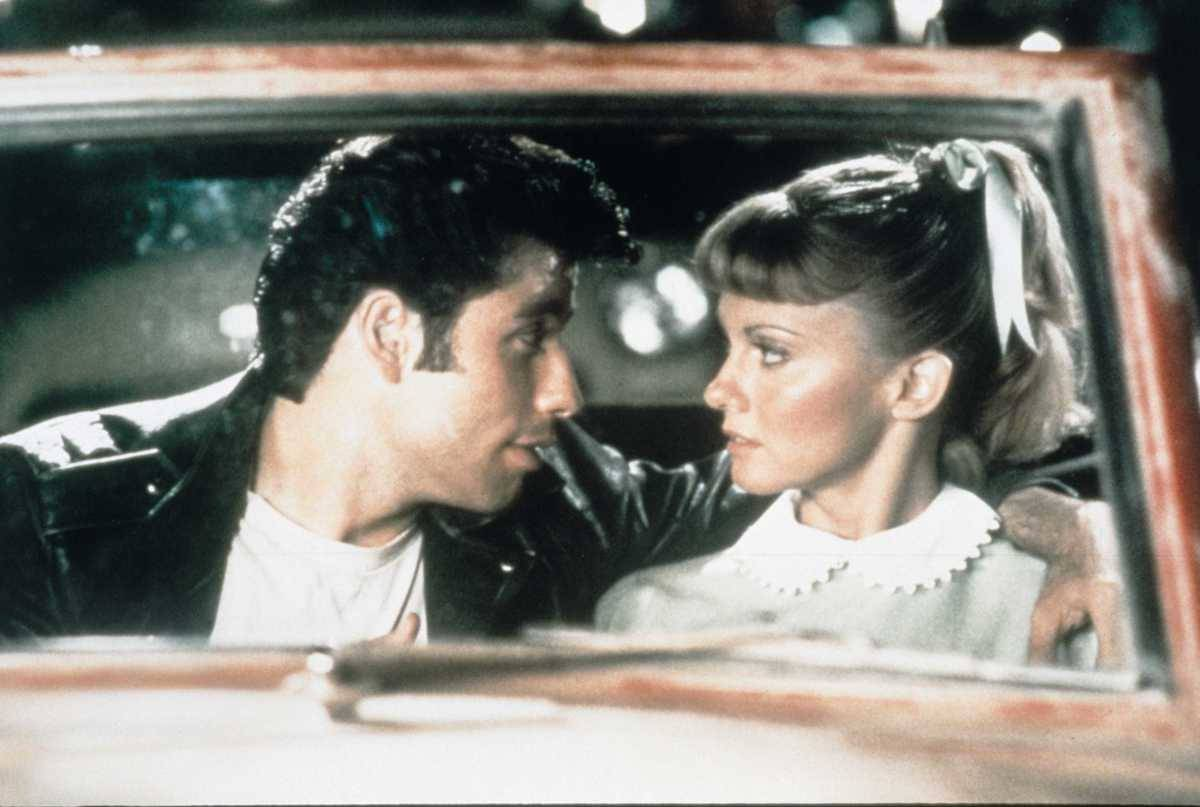 still of danny and sandy in a car from grease