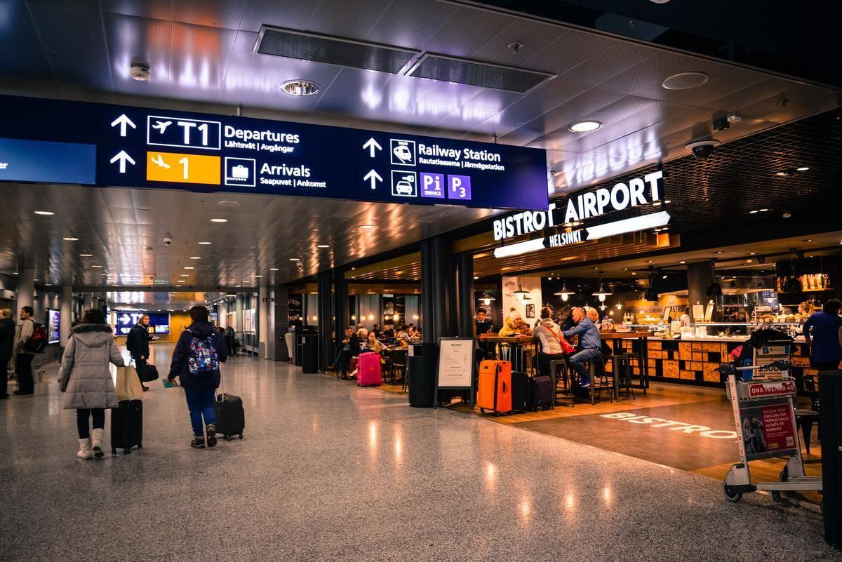 people walking through airport terminal