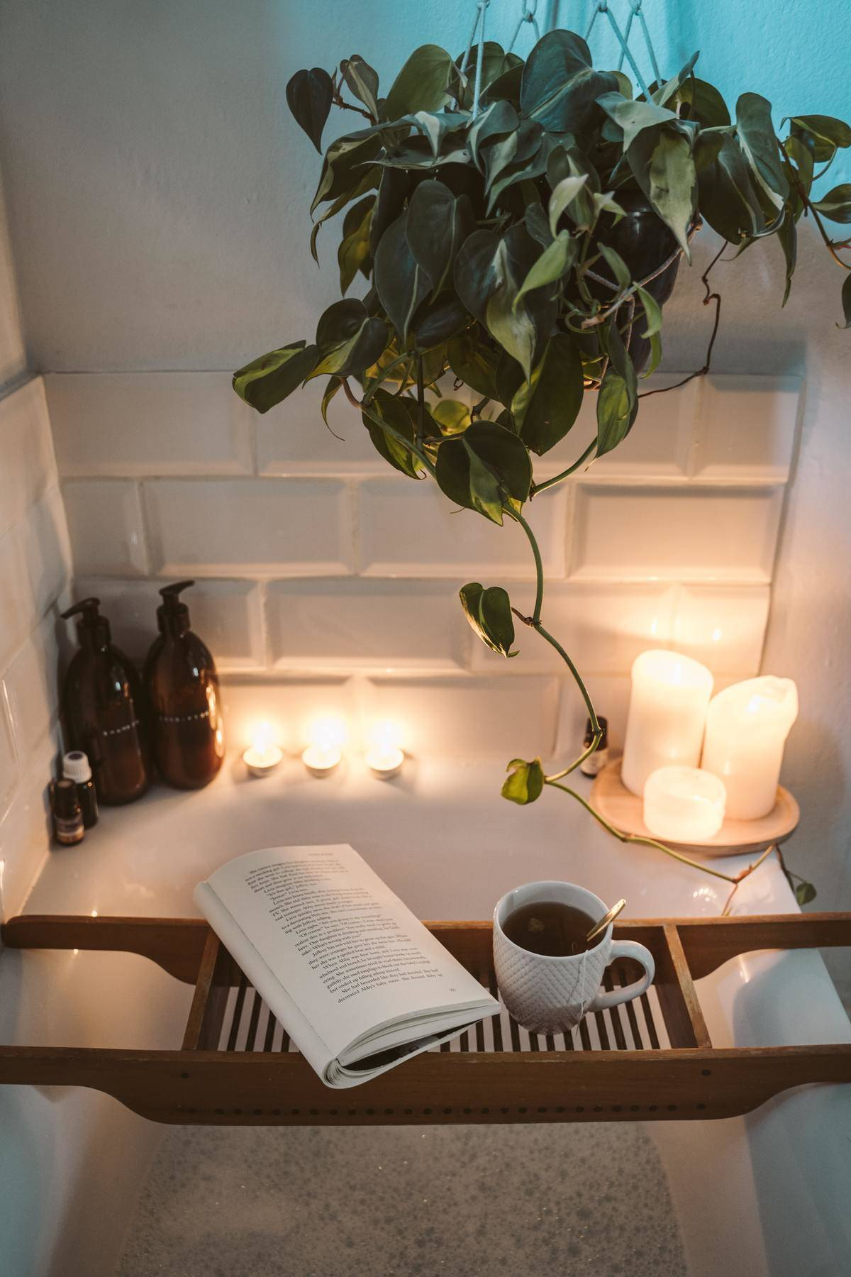 a really nice bath set up with candles and a book