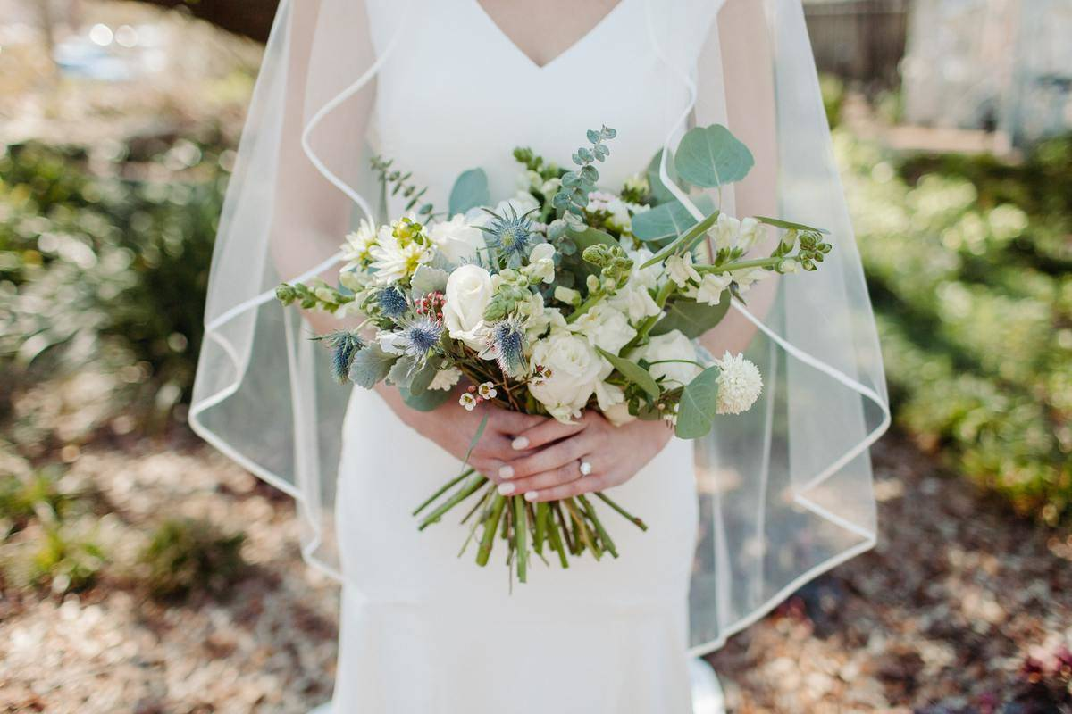 body shot of bride with bouquet