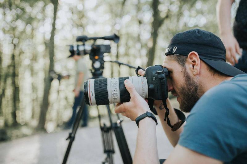 man with camera taking photos