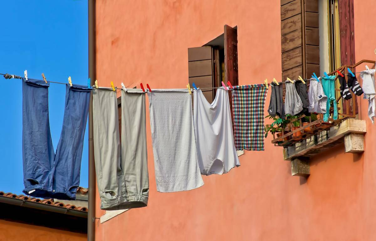clothes hanging on a laundry line in a building