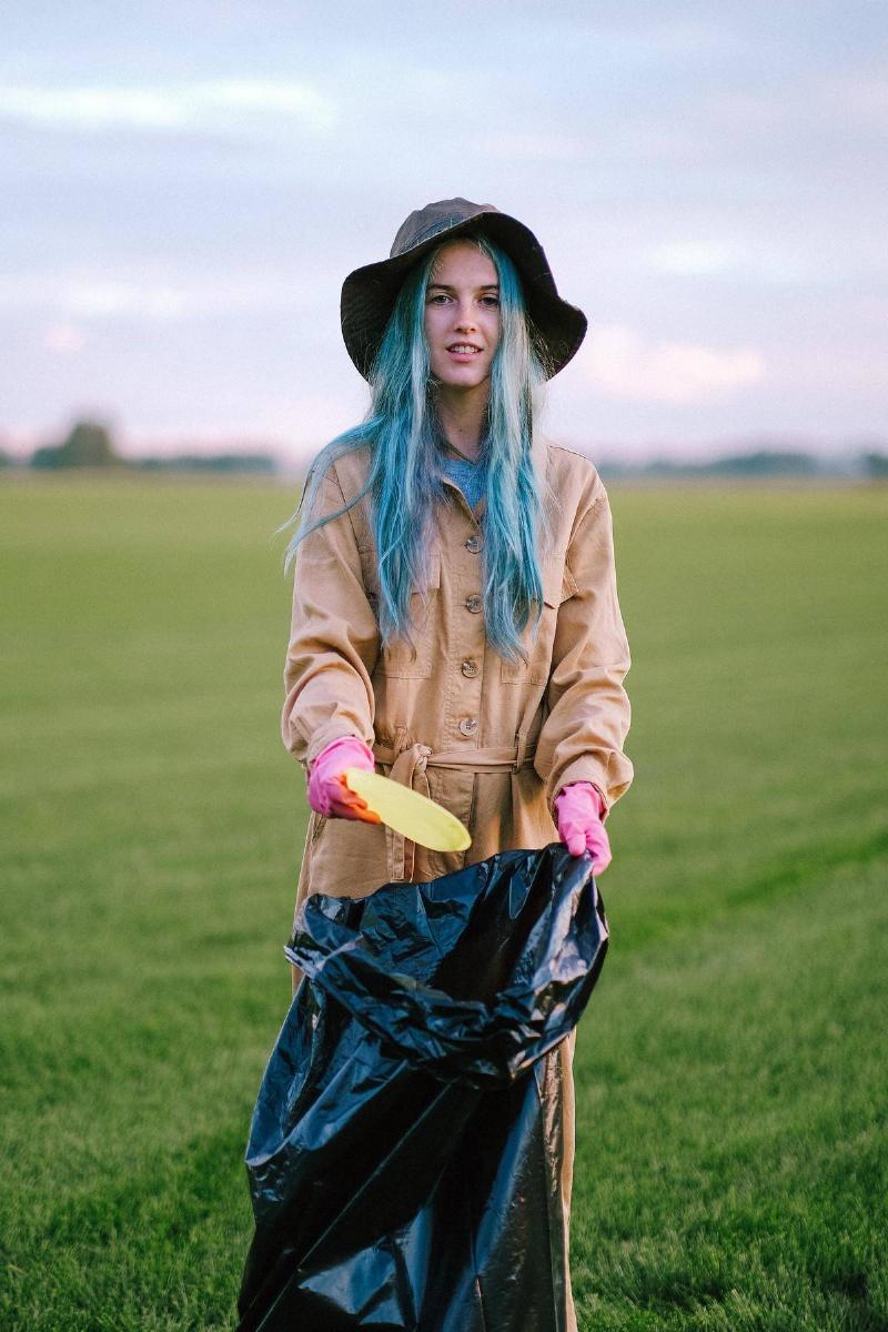 woman picking up garbage