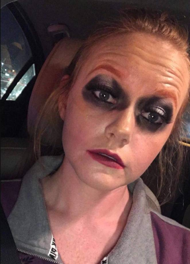 woman with black raccoon eyeliner circles