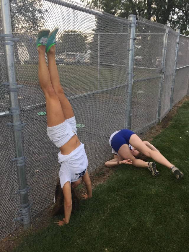 two women trying to do a handstand