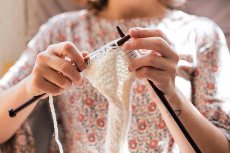 someone knitting