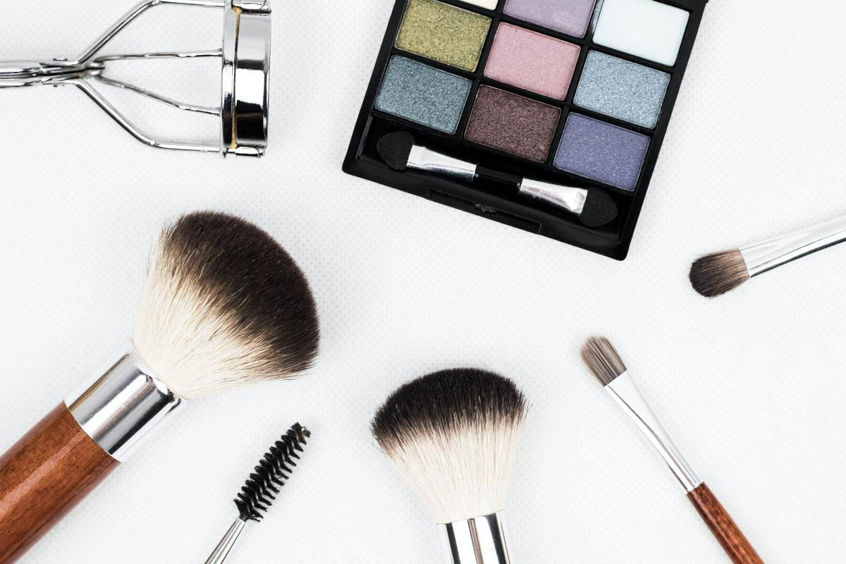 a bunch of makeup and brushes