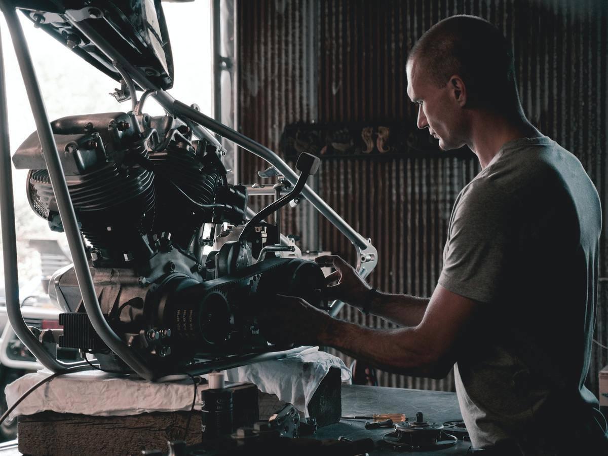 mechanic fixing stuff in a garage